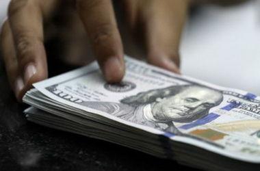 Курс доллара может подскочить еще выше из-за окончания месяца